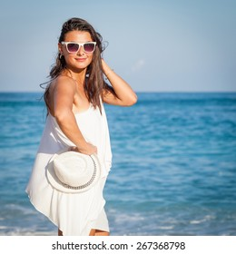 Fashion Lifestyle, Beautiful girl in the sunglasses  on the beach at the day time. Travel and Vacation.