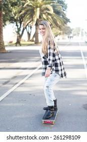 Fashion lifestyle, Beautiful young woman with skateboard