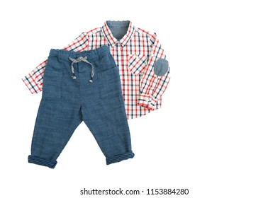 Fashion linen baby-boy (trousers) pants and blue-red caged shirt with long sleeves isolated on white background for spring and autumn wardrobe/ Baby clothes/ Close-up/ Flat lay/ Top view