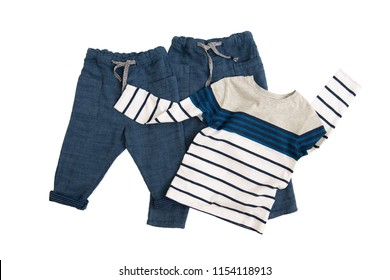 Fashion linen baby-boy (trousers) pants and T-shirt with long sleeves isolated on white background for spring and autumn wardrobe/ Baby clothes/ Close-up/ Flat lay