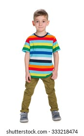 A fashion little boy stands against the white background