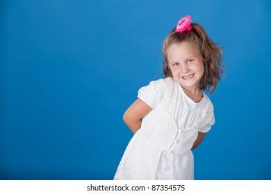 Fashion little girl studio series over blue