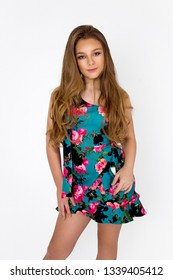 Fashion little girl, teenager model in floral spring dress on a white background in the studio- image