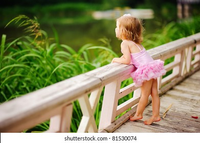 fashion little girl in tutu swimsuit have a fun outdoor