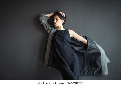 fashion lonely girl in motion posing on dark background