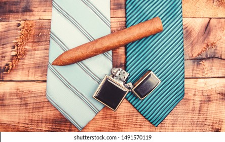 Fashion look. Business detail. male tie and cigar. Male shop. necktie for real men. Modern formal style. vintage. retro style. Cigar and lighter. Wedding elegant accessory. mens club.