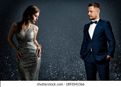 Fashion Luxury Couple. Glamour Woman and Handsome Man. Elegant Pair in evening Dress and Suit. Sparkling Background