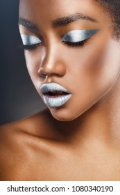 Fashion makeup. Close-up of a young African American woman with silver make-up