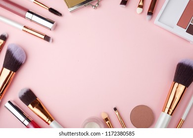 Fashion Makeup Cosmetic accessories on pink background. Top view. Flat lay.