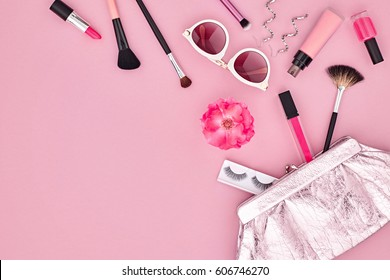 Fashion Makeup Cosmetic Set. Woman Beauty Accessories. Essentials. Design. Lipstick Brushes Eyeshadow, Glamor Stylish Clutch. Rose. Concept. Top view. Flat lay.