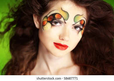 Fashion make-up with face art and hairstyle.