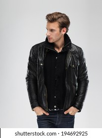 Fashion man, Handsome serious beauty male model portrait wear leather jacket, young guy over gray background