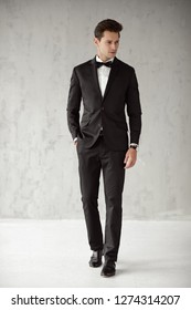 Fashion man wear black suit and bow tie