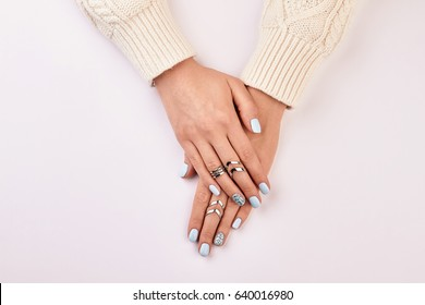 Fashion manicure with accessories. Beautiful silver rings.