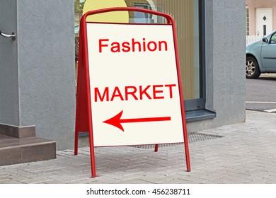 Fashion Market text on  billboard near the entrance on german city street