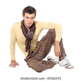 Fashion men pants, a shirt with the white background. Guy sitting