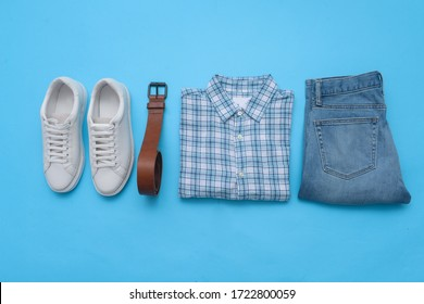 Fashion Men's clothing and accessories on blue background ,flat lay