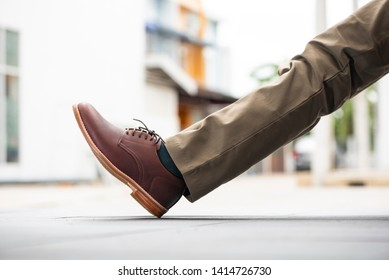 Fashion men's legs with trousers and brown shoes leather for man collection.