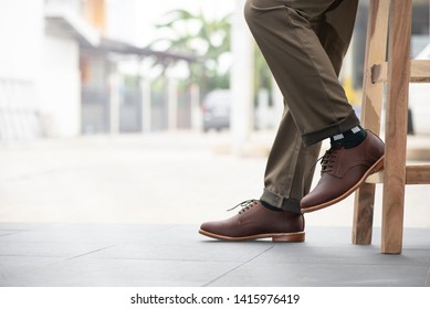 Fashion mens legs with trousers and brown shoes leather for man collection.