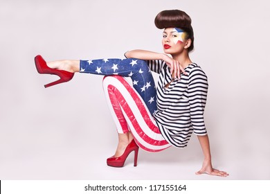 fashion model in american flag leggings with bright makeup