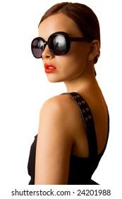 Fashion model in big eyeglasses posing