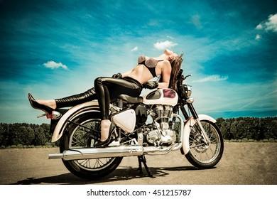 Fashion model biker girl on a motorcycle