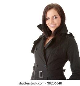 Fashion model in black coat with orthodontic appliance over white background