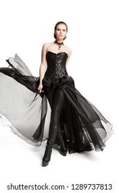 Fashion Model Black Corset Dress, Leather Pants, Beautiful Woman in Gothic Gown Isolated over White Background