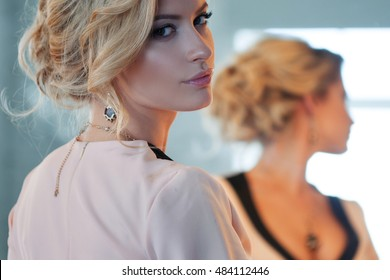 Fashion model with blond hair. Young attractive woman