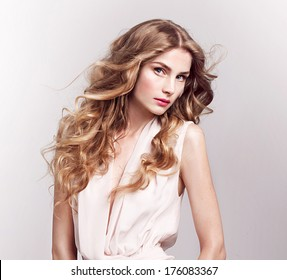 Fashion model with blonde curly hair , spring look,