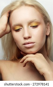 fashion model with bright makeup and manicure hands