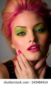 Fashion model with colorful makeup and nails.