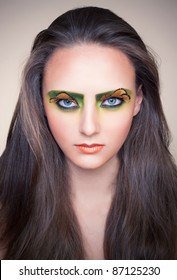 fashion model with creative green make-up