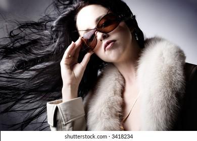 Fashion model with designer sunglasses