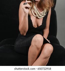 fashion model dressed in black wearing jewelry