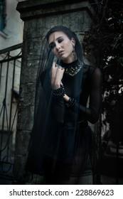 Fashion model dressed in gothic dark style. Vamp style. Dark bride.