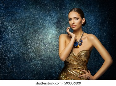 Fashion Model Face Portrait, Elegant Woman in Necklace Jewelry, Young Slim Lady Posing over blue background