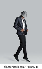 Fashion model floats off the ground in his suit