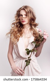 Fashion model with flowers , spring look,