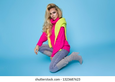 Fashion Model girl full length portrait isolated on blue background. Beauty stylish blonde woman posing in fashionable clothes in studio. Casual style, beauty accessories. High fashion urban style