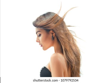 Fashion Model Girl profile Portrait with Long Blowing Hair. Glamour Beautiful Woman with Healthy and Beauty Hair isolated on white background. Fluttering hair