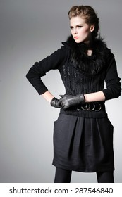 fashion model in gloves in light background