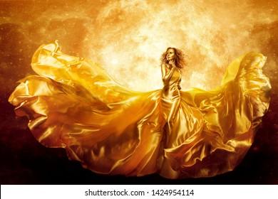 Fashion Model Gold Color Skin, Fantasy Woman Beauty in Artistic Wave Dress, Fliegendes Seidenspiel