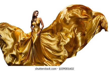 Fashion Model Golden Fly Dress, Elegant  Woman in Fluttering Gold Gown, Beautiful Girl and Silk Fabric Fly, Isolated on White Background