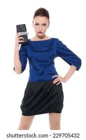 fashion model holding little purse shot on white background in studio