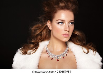 Fashion model with jewelry, modern natural make up. Black background.