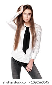 Fashion model with long hair in white shirt and tie isolated on white background
