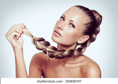 fashion model with long natural hair , hairstyle braid