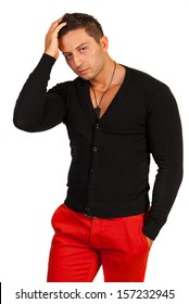 Fashion model male in black shirt and red pants isolated on white background