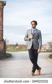 Fashion model man posing in autumn park. Smart casual outfit.